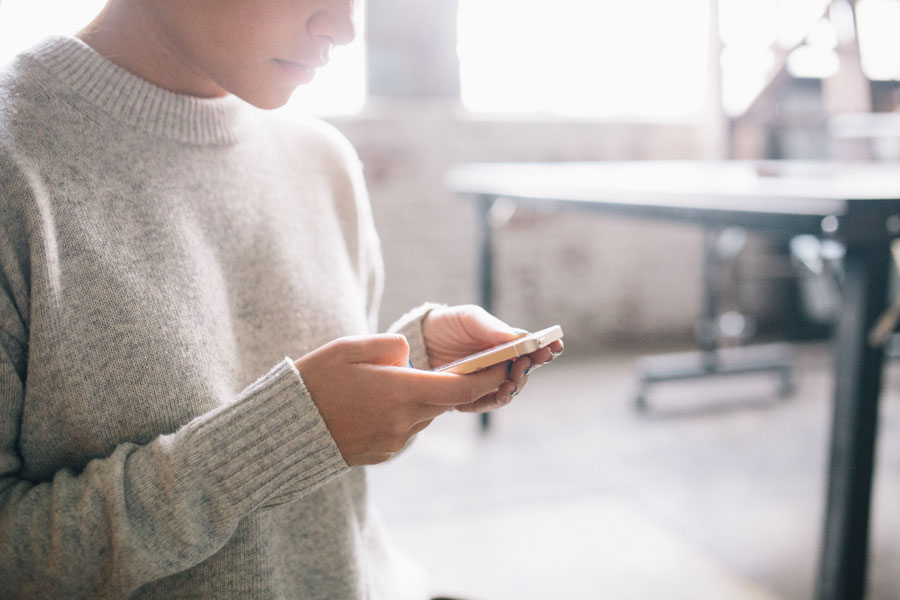 Woman Checking Email on Phone