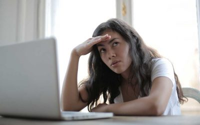 woman annoyed by pop-up advertising on website