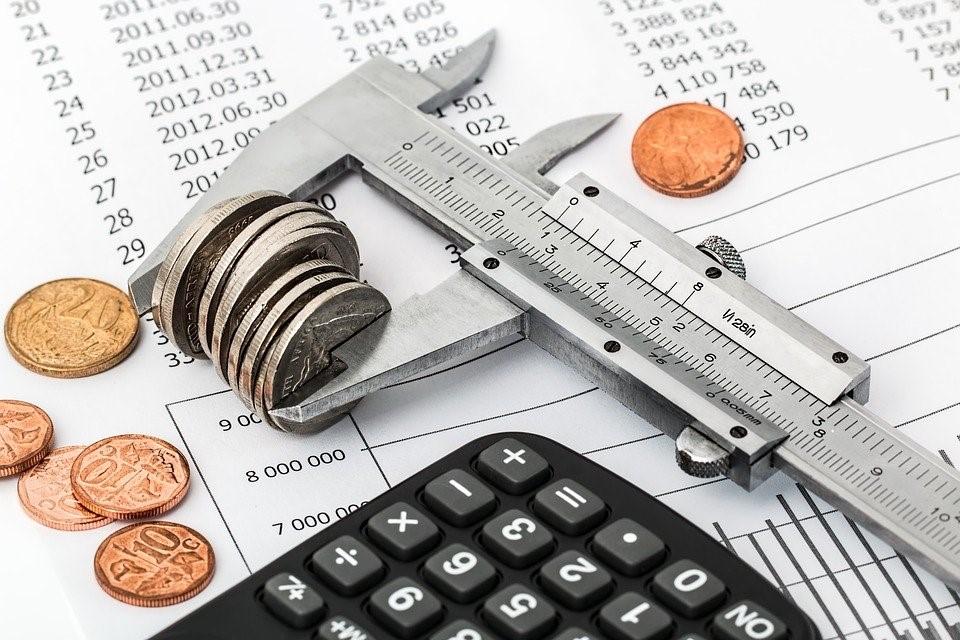 Vernier caliper measuring coins